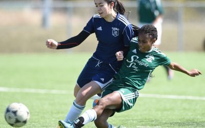 Waterloo, ON - 13-04-16 -  Gaels player #14 Jaia Riggan, right, makes a shot on goal as Vikings player #8 Meghan Hanton-Fong, left, attempts to tackle, in their game at RIM Park on Wed., April 13. Game between Cameron Heights CI Gaels, green jersey, and Waterloo CI Vikings, dark blue, at RIM Park, Waterloo, on Wed., April 13. sp-wcssaagirlssoccer-13 Additional info:	 Preview of WCSSAA girls soccer league. Event location:RIM Park artificial soccer pitch, No. 2. [Peter Lee, Record staff - story by Mark Bryson]  Waterloo Region Record- shot 1:34:33 PM-13-04-16-Wednesday-Waterloo